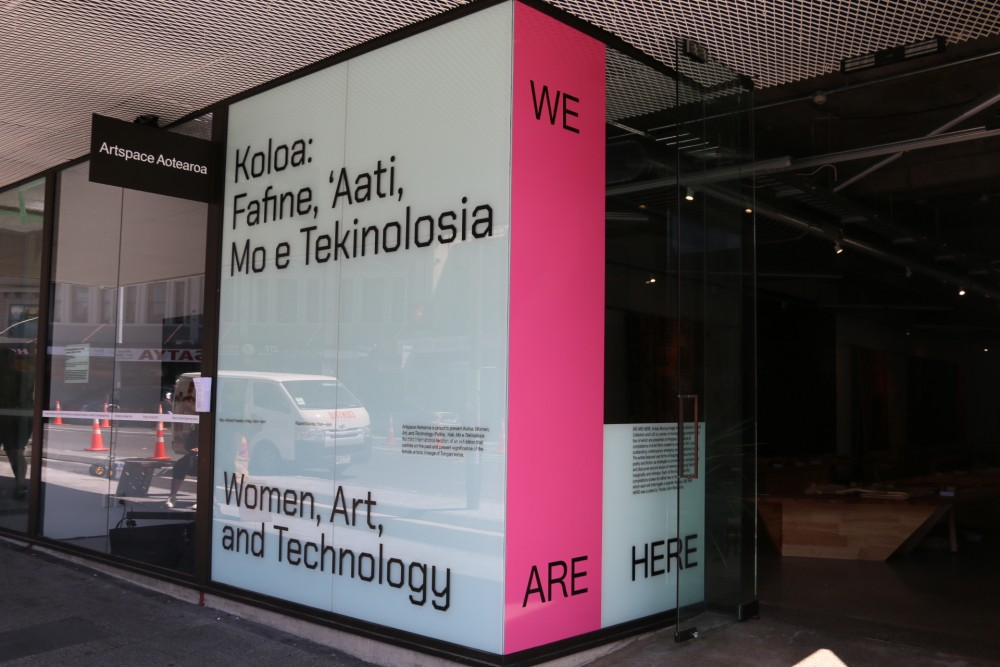 Exterior view: *Koloa: Fafine, 'Aati, Mo e Tekinolosia / Women, Art, and Technology* and *We Are Here*. Vinyl designed by Amy Yalland, 2020.  Photograph by Sam Hartnett