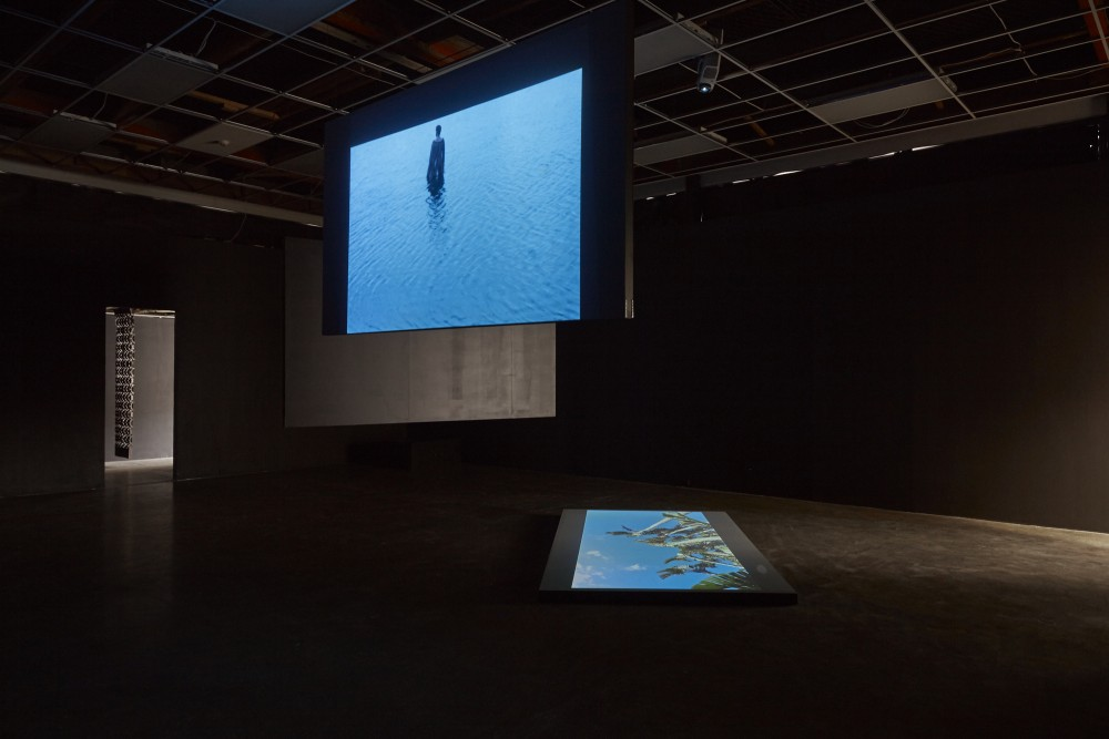Lonnie Hutchinson, *Black Pearl* (2004), Installation (2017) | Video and curtains Albert Ashton, *Te au o te moana* (2017) | Performance Documentation Darcell Apelu, *Touch Down* (2017) | Performance and video