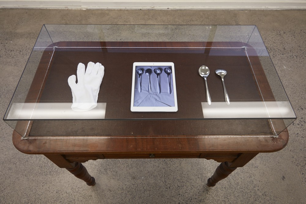 Jasmine Te Hira, *born with silver spoons in our mouths* (2017) | Video, object, custom made vitrine