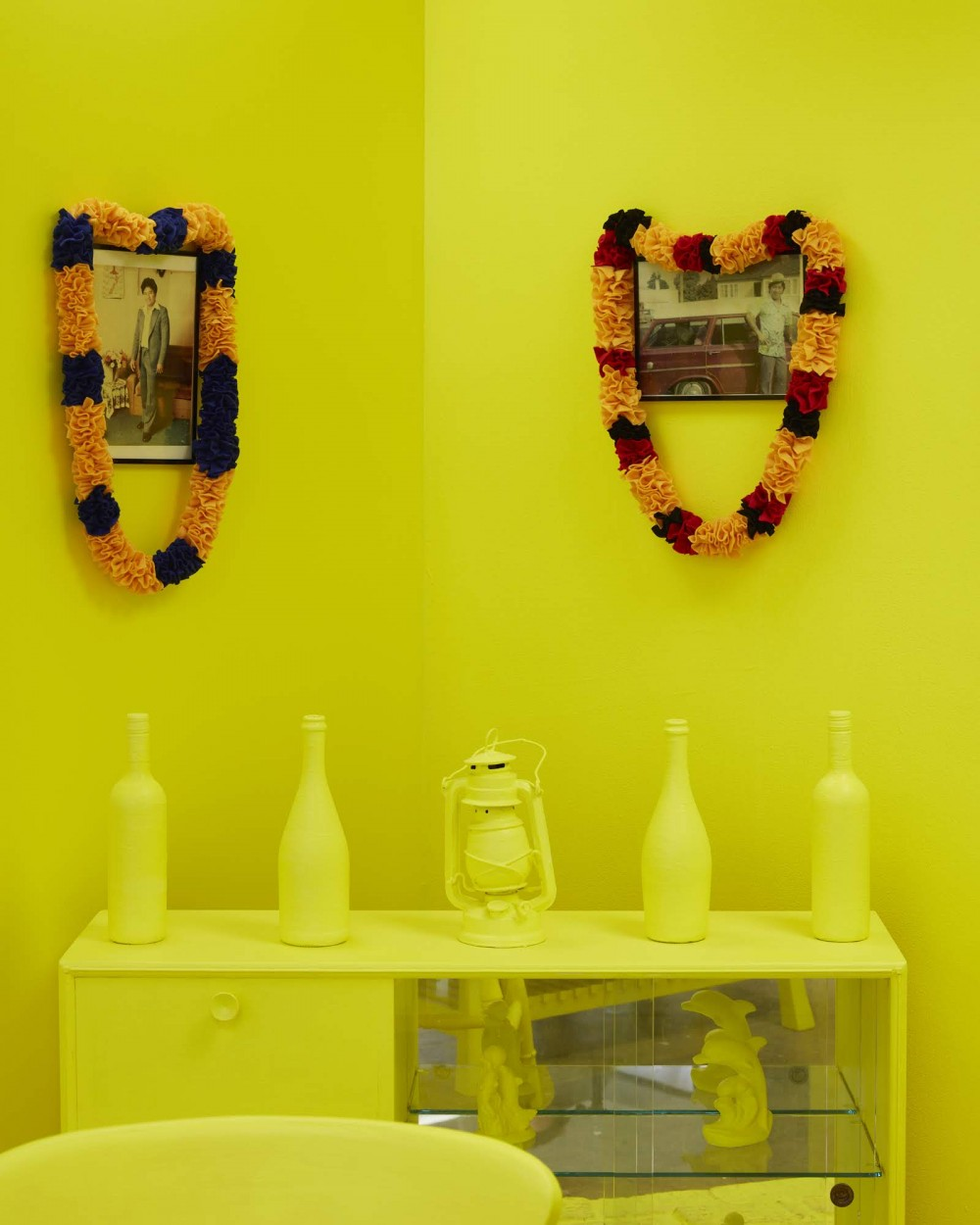 *The River Remains; ake tonu atu*, 2018   9. *The Yellow Brick Road Home* (detail), Faamele Etuale, household items, bricks, felt lei, and old family photos, 2018.   Image: Sam Hartnett 2018